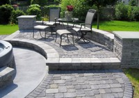 Paving bricks used to create a patio, walkway and retaining wall