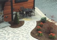 Paving bricks used as a walkway, patio and defines plantings