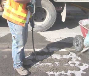vibrating a concrete slab to remove air pockets
